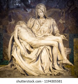 ROME, VATICAN STATE - August 28, 2018: Pietà di Michelangelo (The Pity), 1498-1499, located in St. Peter Basilica in Rome