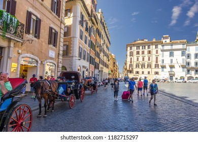 Rome/Italy - August 27, 2018: Piazza di Spagna with horse-waggons and tourists