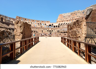 ROME,ITALY - JULY 18,2017 : Tourists at the ruins of the Colosseum in Rome