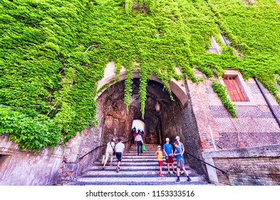 Rome,Italy - July 19, 2018:Tourists climb the ancient staircase under Palazzo Borgia to lead to San Pietro in Vincoli square in Monti district in Rome