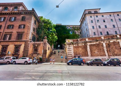 Rome,Italy - July 19, 2018:Tourists climb the ancient staircase under Palazzo Borgia to lead to San Pietro in Vincoli square in Monti district in Rome.
