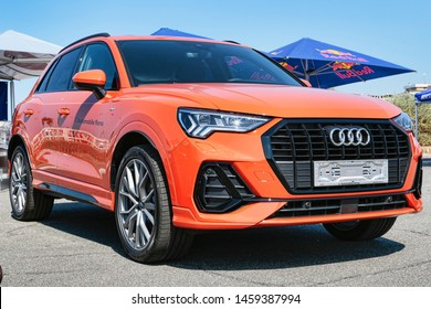 Rome,Italy - July 21, 2019: On occasion of  Rome capital city Rally event, the motor showrooms exhibit new cars models : From Germany a new pulse orange car model Audi Q3 manufactured by Audi