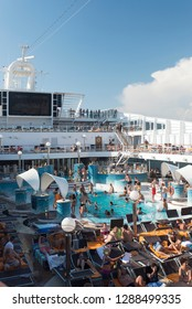 Rome/Italy - September 07 2014: People enjoying a cruising vacation on the pool of MSC Musica. The MSC Musica is the first Musica-class cruise ship built in 2006 and operated by MSC Cruises.