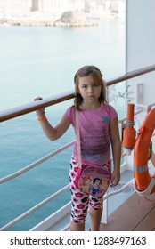 Rome/Italy - September 07 2014: Serious little girl onboard the MSC Musica cruise ship. The MSC Musica was built in 2006 and is operated by MSC Cruises.
