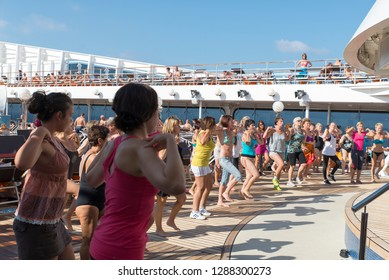 Rome/Italy - September 08 2014: People having a group dance on the deck of MSC Musica. The MSC Musica was built in 2006 and is operated by MSC Cruises.