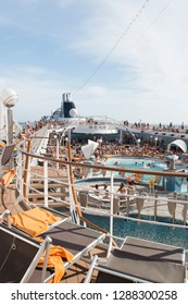 Rome/Italy - September 09 2014: People enjoying a cruising vacation on the pool of MSC Musica. The MSC Musica is the first Musica-class cruise ship built in 2006 and operated by MSC Cruises.