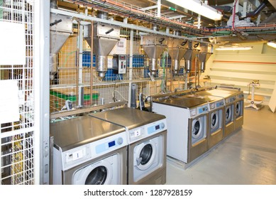 Rome/Italy - September 10 2014: Industrial washing machines inside the laundry of MSC Musica. The MSC Musica was built in 2006 and is operated by MSC Cruises.