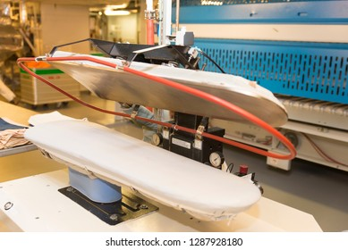 Rome/Italy - September 10 2014: An industrial ironing machine inside the laundry of MSC Musica. The MSC Musica was built in 2006 and is operated by MSC Cruises.