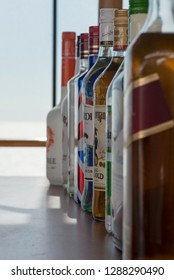 Rome/Italy - September 12 2014: A line of liquor bottles at a bar inside the MSC Musica cruise ship. The MSC Musica was built in 2006 and is operated by MSC Cruises.