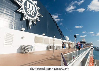 Rome/Italy - September 13 2014: People enjoying a cruising vacation on the deck of MSC Musica. The MSC Musica was built in 2006 and is operated by MSC Cruises.