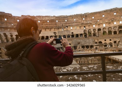 ROME-ITALY-MAY-21-2019:Inside the Colosseum or Coliseum in  Rome Italy. Colosseum is the main travel attraction of Roma. Tourists visit the Colosseum. Panoramic view of Colosseum in the sunlight.