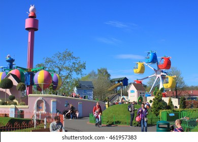 ROMSEY, HAMPSHIRE, ENGLAND, 14 JUN 2016: Visitors and rides at the Peppa Pig World attraction in Paultons Park