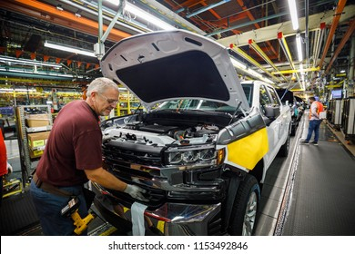 Ron Williams attaches a grill at GM's Chevrolet Silverado and GMC Sierra pickup truck plant in Fort Wayne, Indiana, U.S., July 25, 2018. Picture taken on July 25, 2018.