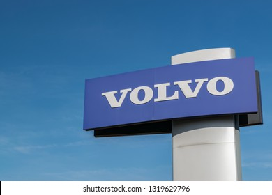 RONCQ,FRANCE-February 20,2019:Volvo brand logo on a blue sky background.Volvo Car Corporation is a Swedish company manufacturing passenger cars, being part of Geely Automobile.