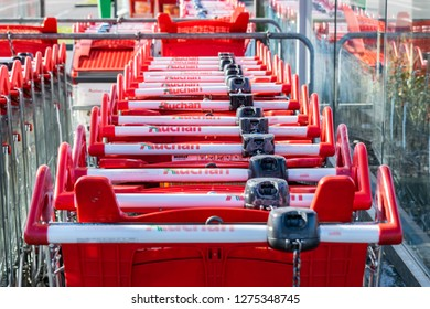Roncq,FRANCE-February 25,2018: Close-up shopping trolleys Auchan hypermarket.Auchan is a French international supermarket chain, is one of the largest distribution groups in the world.
