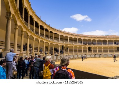 "Ronda, Málaga/Spain - April 27, 2017:  A tour guide was pointing out interesting facts about the famous bullring in Ronda ""Plaza de Toros de Ronda""."