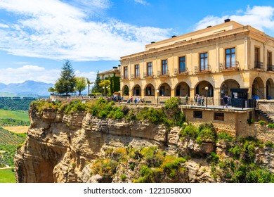 RONDA, SPAIN - MAY 10, 2018: Historic houses in Ronda village in spring, Andalusia, Spain. This town is popular tourist destination.