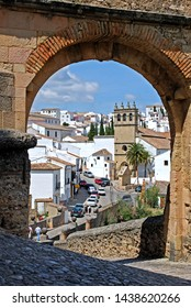 RONDA, SPAIN - MAY 13, 2008 - View through the stone Philip V arch towards the white town, Ronda, Malaga Province, Andalucia, Spain, Europe, May 13, 2008.