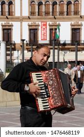 RONDA, SPAIN - OCTOBER 24, 2009 - Spanish man playing a piano accordion in the Plaza del Socorro, Ronda, Malaga Province, Andalucia, Spain, Europe, October 24, 2009.