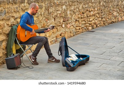 Ronda, Spain-October 12, 2018: Street musician playing at the famous Puente Nuevo Bridge's Ronda historic city center