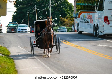 Ronks, PA - September 28, 2014: An Amish buggy near the Lincoln Highway in Lancaster County.