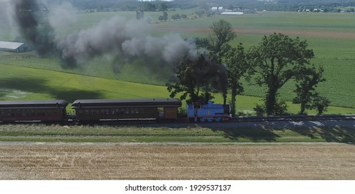 Ronks, Pennsylvania, June 2019 - Aerial View of Thomas the Tank Engine Puffing and Steaming along the Countryside