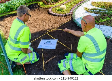 Ronneby, Sweden - June 15, 2018: Professional gardeners planting flowers in a public park, Tingshusparken, in celebration of the 100th anniversary of The Swedish Working Dog Association.