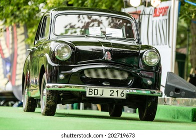 RONNEBY, SWEDEN - JUNE 28, 2014: Nostalgia Festival with classic cars and motorcycles as main attractions. Black Standard 8 classic car.