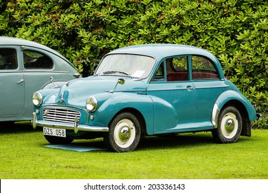 RONNEBY, SWEDEN - JUNE 28, 2014: Nostalgia Festival with classic cars and motorcycles as main attractions. Green Morris minor 1000 1960.