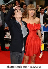 "Ronnie Wood and Ana Araujo arrives for the ""Larry Crowne"" premiere at Westfield, Shepherd's Bush, London. 06/06/2011  Picture by: Alexandra Glen / Featureflash"