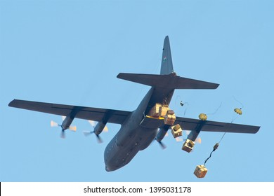 ROODEWAL, SOUTH AFRICA-SEP 17 2018: C130 Hercules deploying supply parachutes  at the SAAF Air Capability Demonstration