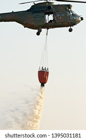 ROODEWAL, SOUTH AFRICA-SEP 17 2018: Oryx helicopter emptying Bambi Bucket at the SAAF Air Capability Demonstration