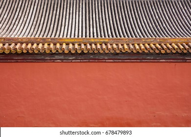 roof of ancient building in Forbidden City gray watt and red wall