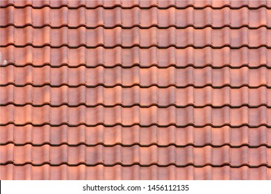 Roof background in new red tiles