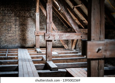 roof beams in old, empty attic / loft before renovation / construction
