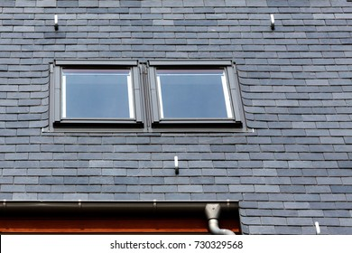 Roof of black slate tiles and skylights Windows