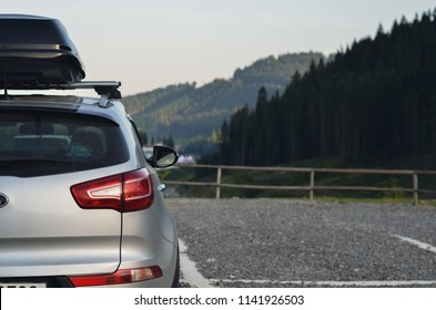 roof box on SUV in mountains