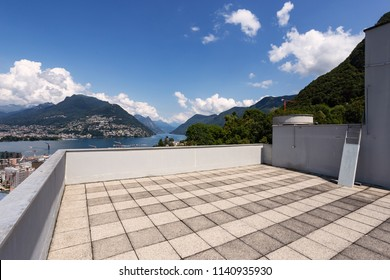 Roof of a building overlooking the lake of Lugano. Summer day