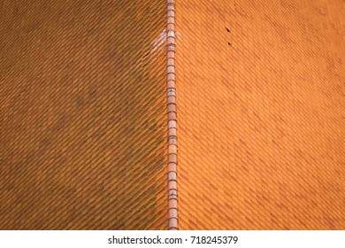 Roof of the building, red tile, view of the buildings from the bird's eye view.