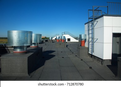 The roof of the building with ventilation hatchways, air conditioning, antennas, electricity.