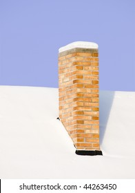 Roof with chimney covered by snow