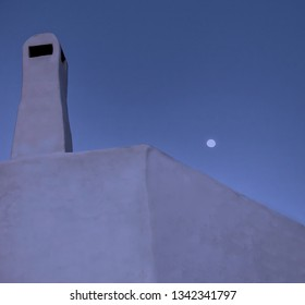 Roof Chimney. Cycladic Minimal architecture . Roof top chimney with blue hour sky and moon in the background. Stock Image.