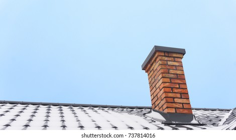 Roof and chimney in winter.