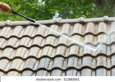 Roof cleaning with high pressure water cleaner