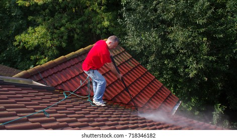 Roof cleaning with high pressure water. A problem with moss and lichen.