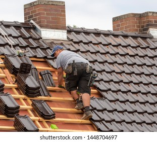 a roof is covered by a roofer, germany, 10.07.2017, Krimnitz