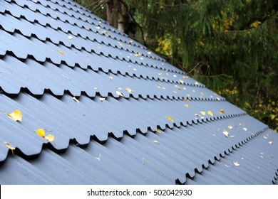 Roof covered with metal tiles