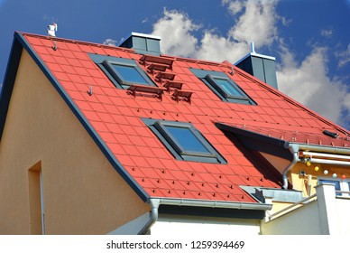 Roof covered with red coated Metal Tiles, Roof Windows, Snow Fence, Eves Gutter, Rain Pipe and Metal plated Chimneys
