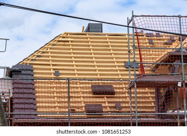 A roof is covered with roof tiles
