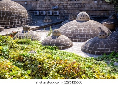 Roof with cupolas of ancient bathhouse (hamam) in Icheri sheher (Old Town) of Baku